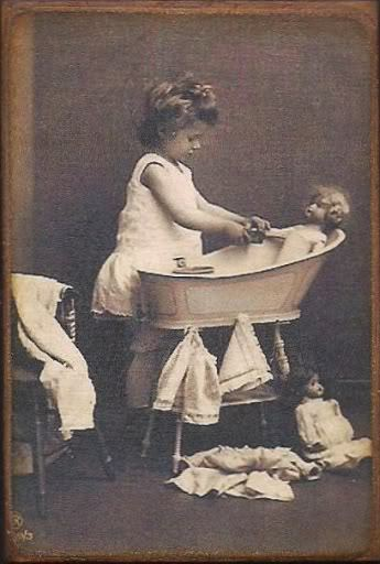 Antique photo girl with doll bathing scene